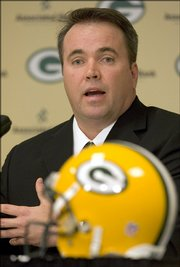 Mike McCarthy answers questions during a news conference in this file photo from Jan. 12, 2006. The former Baker University tight end, who recently signed a contract extension as coach of the Packers, plans to donate $50,000 a year to his alma mater for the next five years.