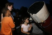 Six-year-old Sammi Dunham takes a closer look at Saturn during an Astronomy Associates of Lawrence public viewing June 25 at South Park.
