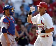St. Louis' Rick Ankiel raises his fist as he crosses home plate after hitting a solo home run in the sixth inning. Ankiel was 3-for-5 with three RBIs, including the game-winning single, in the Cards' 5-4 victory Saturday in St. Louis.