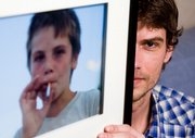 "Photographer Maarten Dors shows his picture of a Romanian child smoking a cigarette entitled ""The Romanian Way"" at his home in Enschede, Netherlands. Without notice, Yahoo deleted the photo from its photo-sharing service, Flickr, on the grounds it violated an unwritten ban on depicting children smoking."