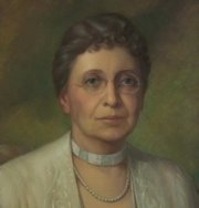 A portrait of Elizabeth Watkins stays up all the time at The Outlook. She willed the house to KU.