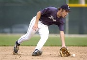 Lawrence Raiders' shortstop Hunter Scheib scoops up a grounder Wednesday during their doubleheader against the Topeka Capitals at Ice Field.