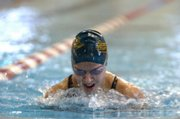 Lawrence's Karley Jarrett, 13, competes in the 100-meter breaststroke Friday, July 11, 2008 during the Wave the Wheat swim meet at the Lawrence Indoor Aquatic Center.