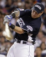Josh Hamilton hit a record 28 home runs in the first round of the Home Run Derby on Monday at Yankee Stadium. But Minnesota's Justin Morneau won the Derby title.