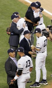New York Yankees' Alex Rodriguez (13) chats with Reggie Jackson, while Yankees manager Joe Girardi (27) talks to Yogi Berra during opening ceremonies for Tuesday's All-Star game at Yankee Stadium.