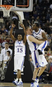 Cole Aldrich, Center, hugs Sherron Collins as Mario Chalmers (15) hoists his fists, signaling Kansas' 59-57 victory over Davidson in the Elite Eight. Collins and Aldrich will provide the most experience on the KU roster next season.
