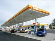 This Shell station in Washington, D.C., offers both regular gasoline and compressed hydrogen. A government-funded study suggested that hydrogen vehicles could be competitive with gas-powered vehicles by 2023, with about $55 billion in government support over 15 years.