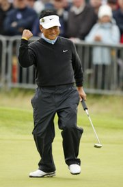 K.J. Choi reacts after his birdie on the 18th hole to take the lead during the second round of the British Open on Friday at Royal Birkdale in Southport, England. Choi has a one-shot lead going into the third round today.