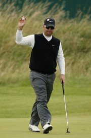 David Duval gestures from the 18th green during the second round of the British Open. Duval, who won the championship in 2001, shot a 1-under 69 on Friday to leave him three strokes off the lead.