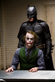 """Heath Ledger, front, plays The Joker in """"The Dark Knight"""" opposite Christian Bale as Batman. Ledger&squot;s performance is a big hit with some fans, and the film set a box office record for a midnight debut."""