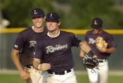 From left, Aaron Rea and Matthew Abel run off the field in smiles after Abel threw an Olathe South runner out at first from center field Friday, July 18, 2008 at Ice Field.
