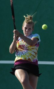 Free State High School senior Lauren Thames returns the ball Thursday during a Lawrence Tennis Association Junior League practice at FSHS.