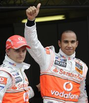 Lewis Hamilton, right, celebrates next to third-place teammate Heikki Kovalainen on Saturday in Hockenheim, Germany.