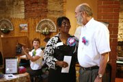 Andrea Partee, left, a Douglas County CASA volunteer, and Guy Dresser, a Citizen Review Board volunteer, greet each other Saturday, July 19, 2008 after being recognized at the CASA4CASA Benefit at Cielito Lindo, 815 New Hampshire St. Partee was awarded the Hon. Jean F. Shepherd Volunteer of the Year Award for CASA while Dresser was awarded the volunteer of the year for CRB.