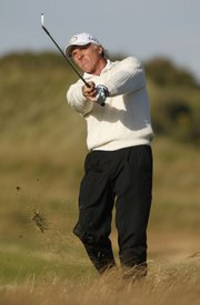 Greg Norman plays on the 15th hole during the third round of the British Open. Norman, who hasn't won a major in 15 years, held a two-shot lead over defending champion Padraig Harrington and K.J. Choi after Saturday's round at the Royal Birkdale Golf Course in Southport, England.