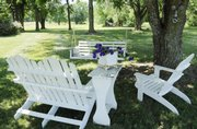 Win and Linda Campbell's home and yard southwest of Lawrence offer several shaded seating areas with scenic views.