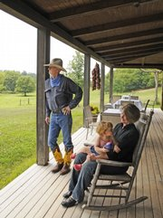 Jack Cronemeyer, his wife, Mary, and daughter Dakota, 17 months old, own the Circle S Ranch north of Lawrence. A substantial number of their guests are Kansas locals seeking a unique, but close, weekend getaway.