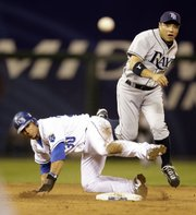 Tampa Bay second baseman Akinori Iwamura, right, and Kansas City shortstop Mike Aviles watch as Iwamura throws to first in an unsuccessful double-play attempt  Saturday in Kansas City, Mo.