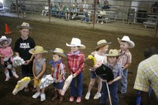 Stick horse show competitors of various ages wait for the award announcement Sunday, July 27, 2008 during the Open Horse Show at the Douglas County Fairgrounds.