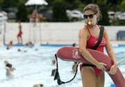 Lifeguard Julia Guard keeps watch over the children's swimming area at the Lawrence Outdoor Aquatic Center. Each lifeguard does three 20-minute shifts, followed by one 20-minute break.