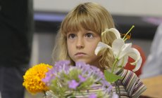 Holly Vesecky, 7, of the Vinland Valley 4-H Club, enters her flowers for judging Tuesday morning at the Douglas County Fair.