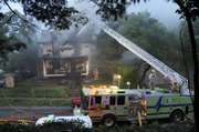 Lawrence Douglas County Fire and Medical crews respond to a house fire at 1005 Indiana on Thursday. The fire started about 5:15 a.m.