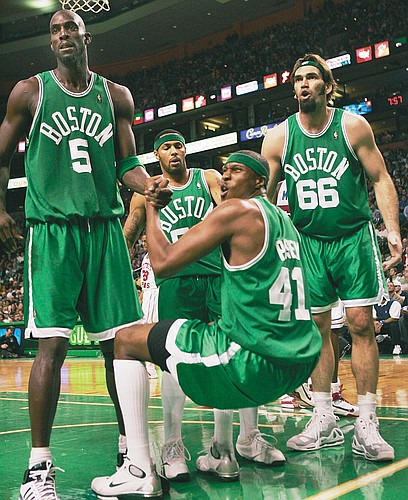 Boston's Scot Pollard (66), Kevin Garnett (5), James Posey (41) and Eddie House complain to a referee in this December 2007 file photo. Pollard, a free agent, isn't ready for his NBA career to be over.