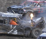 Anthony Newcome's car erupts into flames during the Demolition Derby on Aug. 1, 2008, at the Douglas County Fairgrounds. Winning a demolition derby usually takes more than driving around ramming into people all willy-nilly.