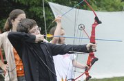 Preston Foster,11, Tonganoxie, tests his skills at an archery class at Prairie Park Nature Center, 2730 S.W. Harper St. The center recently began offering the classes.