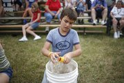 Nine-year-old Ian Beach, of Vinland, shells corn Thursday, Aug. 7, 2008 during a Old-time Farm Skills Contest at the Vinland Fair.