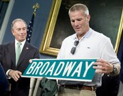 New York Mayor Michael Bloomberg, left, presents new New York Jets quarterback Brett Favre with a Broadway street sign at a news conference. The media event was Friday at New York's City Hall.