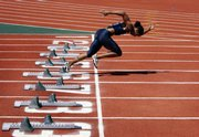 U.S. women's 100-meter sprinter Torri Edwards practices on the starting pad during her morning training for the Beijing Olympic Games at a university in Dalian, Liaoning province, China.
