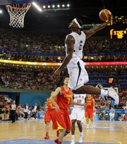 LeBron James (6) goes in for a dunk against China. The U.S. men won their Olympic opener, 101-70, Sunday in Beijing.