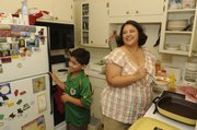 Susana Mariscal del Villar and her son prepare dinner for the family. Past Fulbright scholars left the residence furnished for the family.