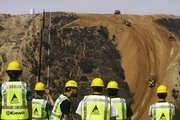 A U.S. construction crew works Friday to fill the Smuggler's Gulch near the U.S.-Mexico border in San Diego. Scrapers and bulldozers began filling the deep canyon Friday to make way for a border fence in the southwestern corner of the continental United States after 12 years of planning, environmental reviews and legal challenges.