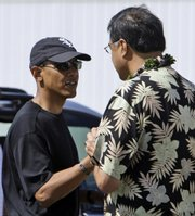 "Democratic presidential candidate Sen. Barack Obama, D-Ill., shakes hands with Honolulu Mayor Mufi Hannemann at the airport Friday before boarding a plane to leave Honolulu after vacationing in Hawaii. The Obama campaign has created a 41-page refutation to author Jerome Corsi&squot;s book, ""Obama Nation: Leftist Politics and the Cult of Personality."""