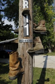 Old boots appear to be stuck into a telephone pole outside the Barlows' BKB Leather shop.