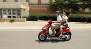 KU students Miles and Molly McGonigle, from Kansas City, Kan., cruised campus on Tuesday.