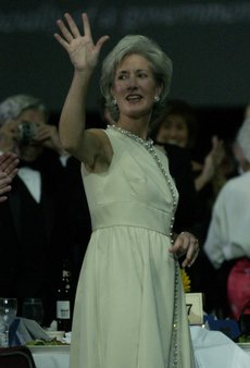Kansas Governor Katheleen Sebelius acknowledges the crowd at the Inauguration ball dinner at the Kansas Expo Centre in Topeka.