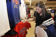Kansas University sophomore Amanda Garley, of Whitefish Bay, Wis., shops for Jayhawk merchandise on Wednesday at the KU Bookstore in the Kansas Union.
