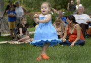 A young girl dances to music in South Park Sunday, August 24, 2008, during the 28th annual Kansas State Fiddling and Picking Championships.