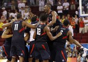 Kobe Bryant, top right, leaps on his U.S. men's basketball teammates after the gold-medal game at the Olympics. The U.S. men won the gold Sunday in Beijing.