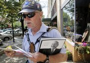 Jerry Totten makes his mail deliveries Tuesday, to addresses along Massachusetts Street. His route is Massachusetts and New Hampshire streets from the 600 to 1100 blocks.