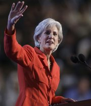 """Kansas Gov. Kathleen Sebelius waves as she gets ready to address the Democratic National Convention in Denver. Sebelius used her time on the national stage Tuesday to attack Republican candidate John McCain&squot;s """"country club economics."""""""