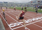 Lawrence High's Kristina Taylor leans over the finish in the 400-meter preliminaries of the Kansas Relays at Memorial Stadium in this April 17 file photo. With a new track facility in the works, 2009 might be the last year the Kansas Relays take place at Memorial Stadium.