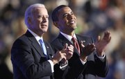 Sen. Barack Obama, right, makes a surprise appearance with his running mate, Sen. Joe Biden, Wednesday at the Democratic National Convention in Denver.