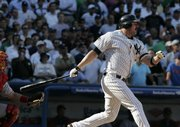 New York's Jason Giambi follows through on his game-winning single. The Yankees defeated Boston, 3-2, on Thursday in New York.