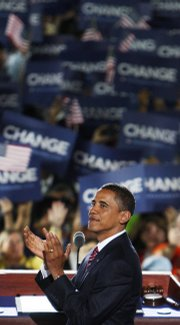 Democratic presidential nominee Sen. Barack Obama, D-Ill., applauds before giving his acceptance speech Thursday at the Democratic National Convention in Denver.