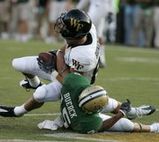 Wake Forest receiver Chip Brinkman, top, catches a touchdown pass as Baylor's Krys Buerck tries to break it up in Wake Forest's 41-13 victory Thursday in Waco, Texas.