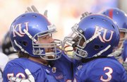 KU lineman Ryan Cantrell and running back Jocques Crawford congratulate each other after one of Crawford&#39;s touchdown runs in the first half against Florida International on Saturday, August 30, 2008 in Memorial Stadium.